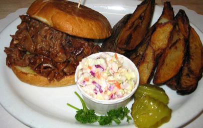 The Coach House - Barbecue beef sandwich lunch with french fries